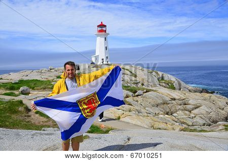 Man waving Nova Scotia flag
