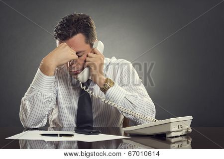 Overwhelmed  Businessman With Headache
