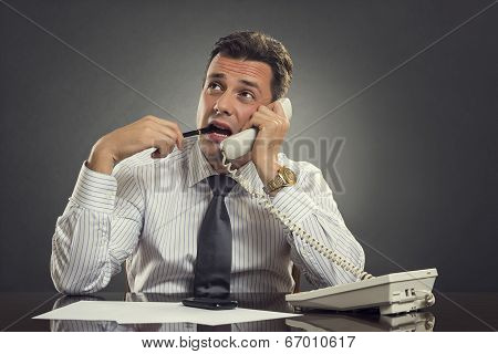 Thoughtful Businessman On Phone