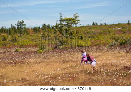 Mom With Daughter Piking Cranberry