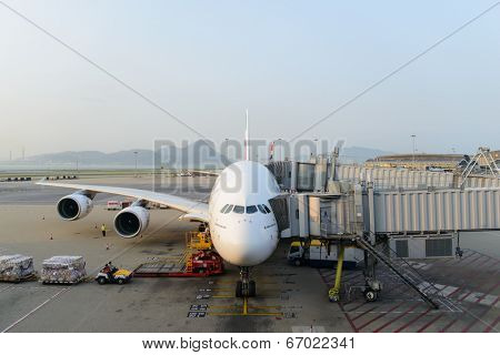 HONG KONG - APRIL 17: Emirates A380-800 docked in Airport on April 17, 2014 in Hong Kong. Hong Kong International Airport  is one of the best airport in the annual passenger survey by Skytrax.
