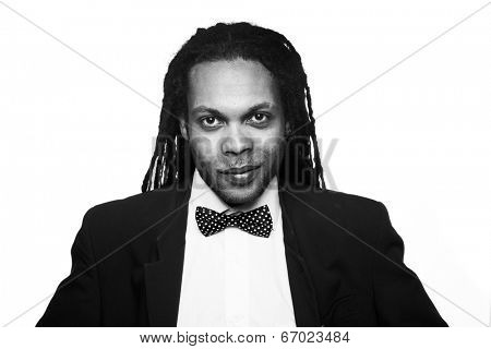 rasta man wearing suit and bow black and white portrait