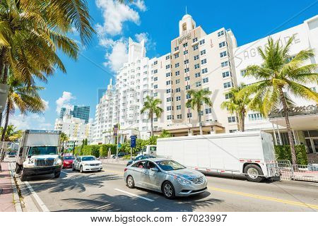 MIAMI, USA - MAY 20,2014 : Famous art deco hotels and traffic at Collins Avenue on a sunny day at Miami Beach