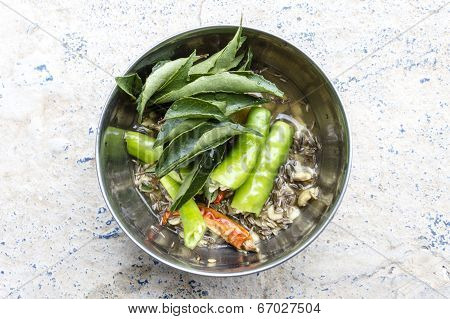 raw ingredients like curry leaves, chillies, cumin seeds & pulses to make masala