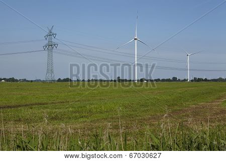 Wind Turbines, Power Pole And Power Lines