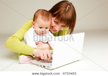Mother And Baby At Laptop