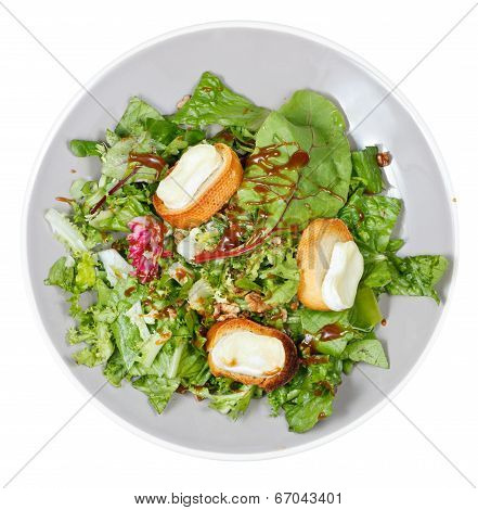 Top View Of Green Salad With Goat Cheese On Plate