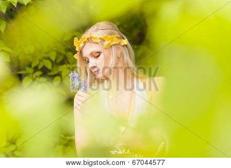 Beautiful Girl And Green Leaves