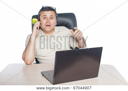 Man Holding Phone And Looking Surprised.