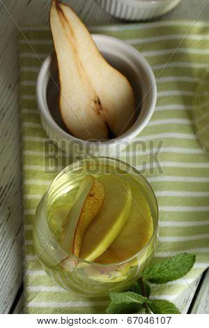 Sangria drink in glass on color napkin background