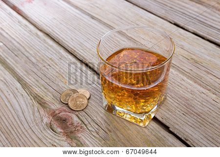 Tumbler Of Whiskey And Tip On A Bar Counter