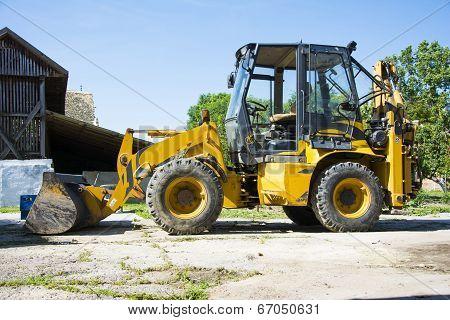 Digger In A Backyard