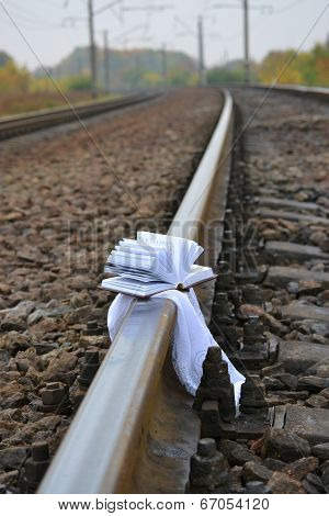 Disclosed Little Book Lies On The Rail