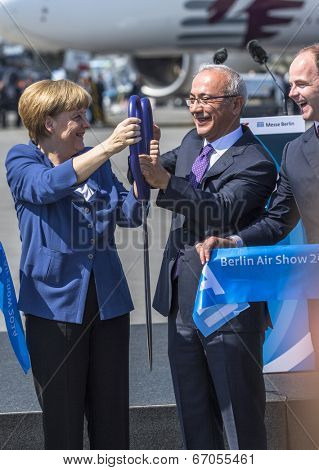 BERLIN, GERMANY - MAY 20, 2014: German Chancellor Angela Merkel, Turkish Minister of transport Lutfi Elvan and CEO Mr Christian (L.-R.) open up the International aviation and space exhibition ILA.