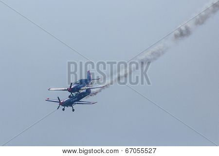 BERLIN, GERMANY - MAY 21, 2014: Two Extra-300, D-EAXK - aerobatic planes (Germany), demonstration during the International Aerospace Exhibition ILA Berlin Air Show-2014.