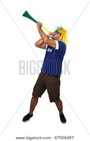 Brazilian fan playing vuvuzela on white background