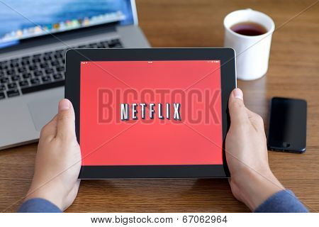 Male Hands Holding Ipad With App Netflix On The Screen In The Office