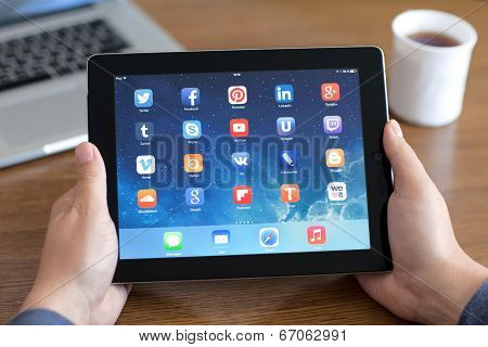 Male Hands Holding Ipad With Social Media App On The Screen In The Office