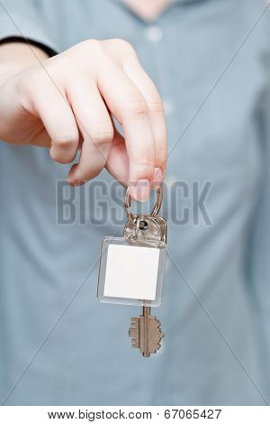 Blank Key Fob In Hand Close Up