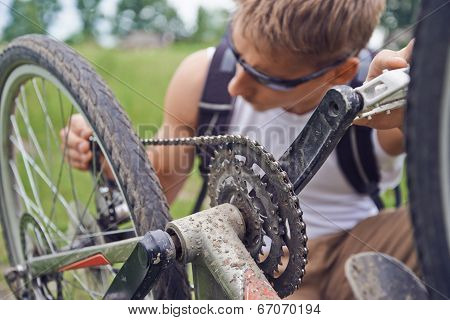 Cyclist Man Checks Chain