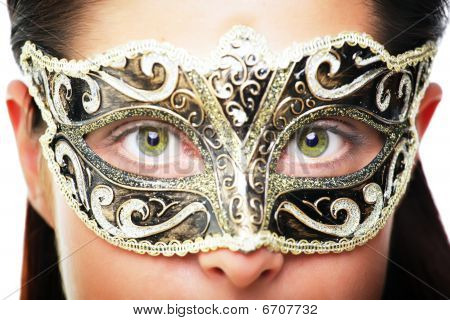 Close-up of a beautiful young woman in carnival mask