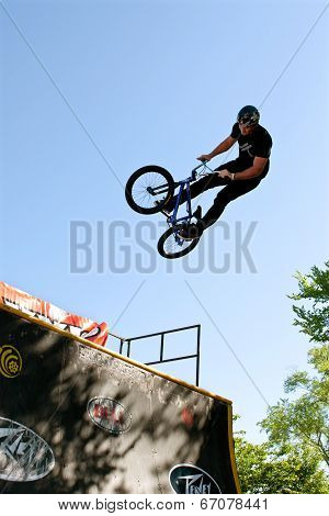 Young Man Practices Jump Tricks At Bmx Competition