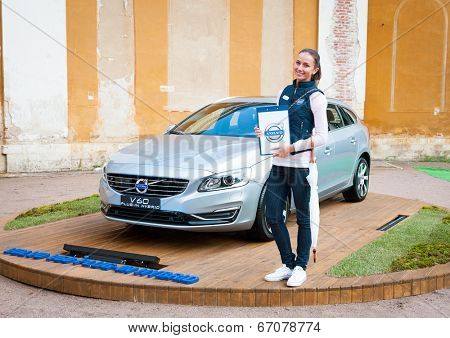 MOSCOW - JUNE 14: Woman presents Volvo hybrid car v60 model at open-air concert on XI International Jazz Festival