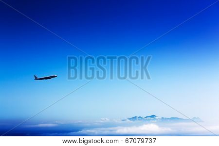 airliner in the stratosphere  over the mountains and clouds