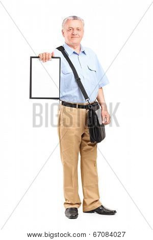 Full length portrait of a mature mailman holding a clipboard isolated on white background