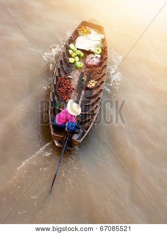 Vietnam, Mekong river delta. Boat on traditional floating market