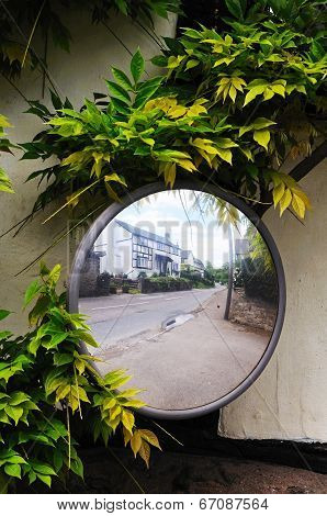 Convex road safety mirror.