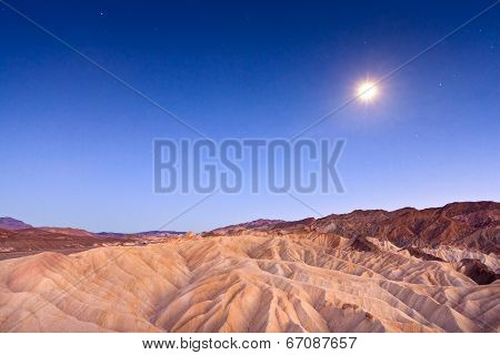 Desert Sunset And Moonlight