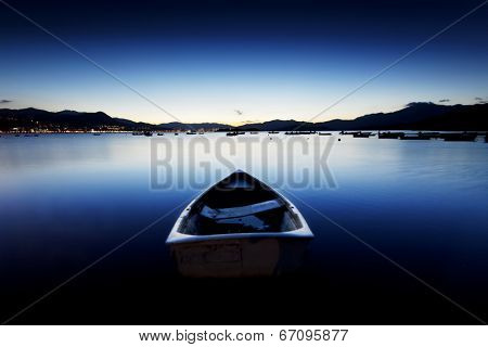 sunset on the lake with boat