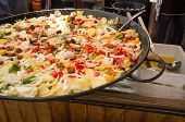 stock photo of stew  - Traditional Spanish stew being cooked patatas a lo pobre - JPG