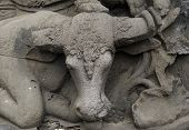 image of moo-cow  - Detail of an ornate Buddhist stone carving of a cow - JPG