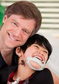 picture of 7-year-old  - Handsome father holding disabled seven year old son smiling together - JPG