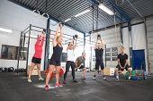 pic of kettlebell  - Group training with personal trainer and instructor at a fitness center - JPG