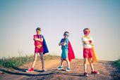 stock photo of instagram  - kids acting like a superhero retro vintage instagram filter - JPG