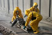 image of nuclear disaster  - Man in chemical protection suit carrying out the decontamination area