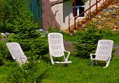 stock photo of lawn chair  - Two desk chairs on green grass lawn - JPG