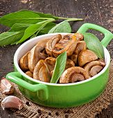 stock photo of sauteed  - Sauteed mushrooms on the old wooden background - JPG