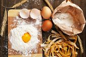 picture of pasta  - Still life with raw homemade pasta and ingredients for pasta - JPG