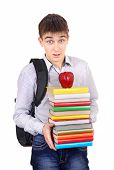stock photo of knapsack  - Surprised Student with Knapsack Holding the Books Isolated on the White Background - JPG