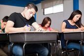 stock photo of students classroom  - Several high school students taking a test in a classroom - JPG