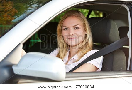 Attractive woman in her car