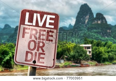 Live Free Or Die sign with a exotic landscape on background