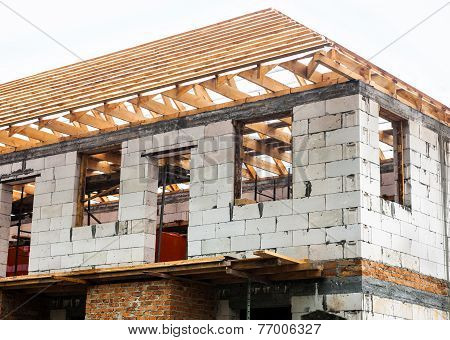Unfinished House With Timber Roof Truss