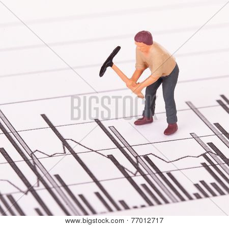 Miniature Worker Working On A Graph