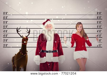 Jolly Santa smiling at camera against mug shot background