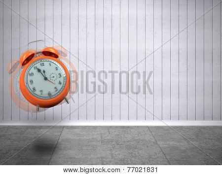 Alarm clock counting down to twelve against grey room